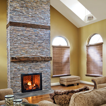 rustic fireplace in a room with high ceilings