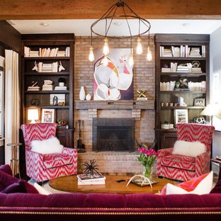 Small eclectic living room library photo in Boise with a standard fireplace, a brick fireplace and no tv