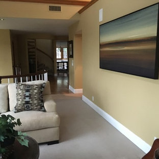Example of a mid-sized classic formal and open concept carpeted and gray floor living room design in Orange County with beige walls