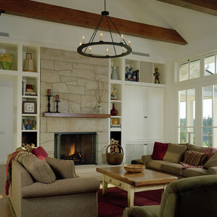 Inspiration for a rustic living room in Seattle with a stone fireplace surround.