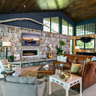 Mountain style open concept gray floor living room photo in Miami with brown walls, a ribbon fireplace and a wall-mounted tv