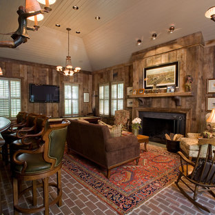 Rustic living room in Baltimore with brown walls, brick flooring and a standard fireplace.