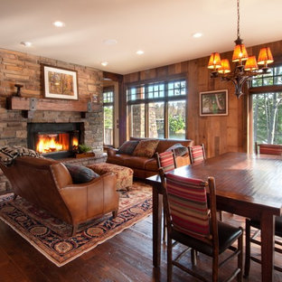 Inspiration for a rustic living room remodel in Minneapolis with a two-sided fireplace, a stone fireplace and no tv