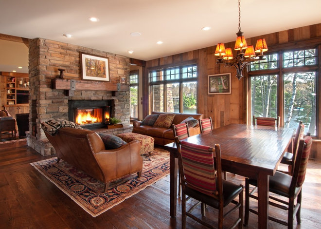 Rustic Living Room by Manomin Resawn Timbers