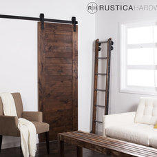 Rustic Living Room by Rustica Hardware