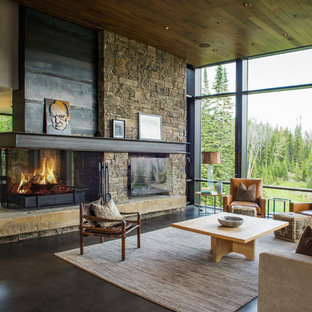 Example Of A Large Mountain Style Open Concept Concrete Floor And Gray  Floor Living Room Design