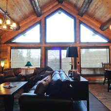 Rustic Living Room by Mountain Log Homes & Interiors