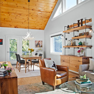 Inspiration for a rustic open concept medium tone wood floor living room remodel in Burlington with white walls