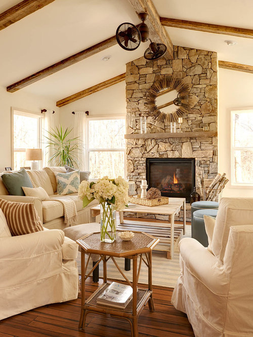 Best Farmhouse Living Room With A Stone Fireplace Surround Design Ideas