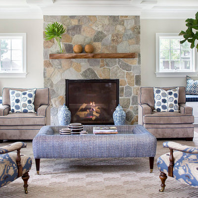 Example of a mid-sized transitional formal and enclosed living room design in New York with beige walls, a standard fireplace, a stone fireplace and no tv