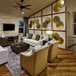 Transitional Medium Tone Wood Floor Living Room Photo In Denver With A Wall Mounted Tv
