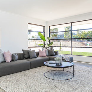Photo of a scandinavian enclosed living room in Melbourne with white walls and multi-coloured floor.