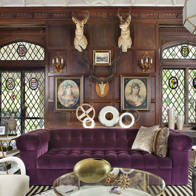 Example of an eclectic living room design in New York with brown walls