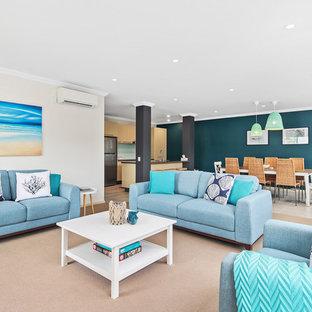 メルボルンの中サイズのビーチスタイルのおしゃれなLDK (フォーマル、ベージュの壁、暖炉なし、ベージュの床) の写真