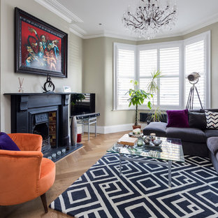 Classic formal enclosed living room in London with beige walls, light hardwood flooring and beige floors.