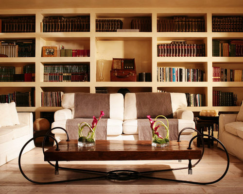 Example of a trendy living room library design in Rome