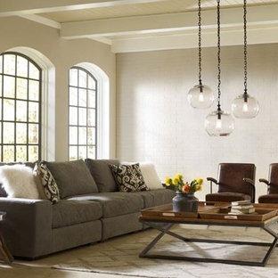 モントリオールのシャビーシック調のおしゃれなLDK (ベージュの壁、コンクリートの床、暖炉なし、テレビなし) の写真