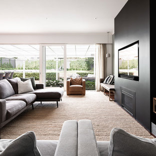Contemporary formal open concept living room in Perth with grey walls, medium hardwood floors, a ribbon fireplace, a built-in media wall and brown floor.