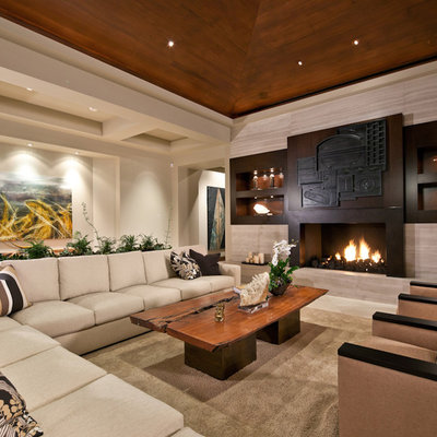Huge trendy living room photo in San Diego with beige walls, a standard fireplace and no tv