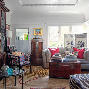 Example of an eclectic enclosed living room design in San Francisco with white walls