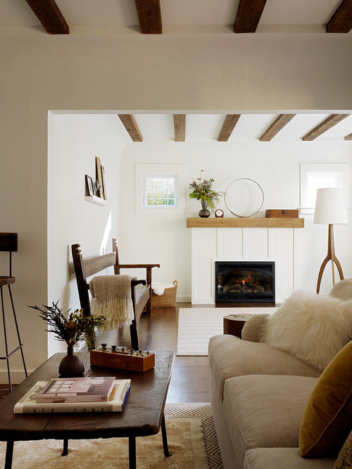 Example Of A Mountain Style Living Room Design In San Francisco With White Walls And