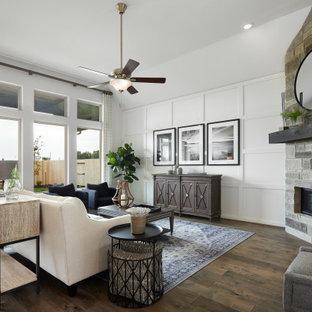 他の地域の中くらいのトランジショナルスタイルのおしゃれなLDK (白い壁、濃色無垢フローリング、コーナー設置型暖炉、石材の暖炉まわり、茶色い床、パネル壁) の写真