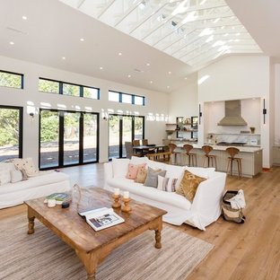 Inspiration for a huge cottage open concept medium tone wood floor and brown floor living room remodel in San Diego with white walls