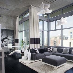 Idee per un soggiorno industriale con pareti grigie