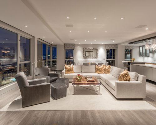 Example Of A Large Trendy Open Concept Light Wood Floor And Gray Floor Living  Room Design