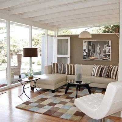 Mid-sized trendy medium tone wood floor living room photo in San Francisco