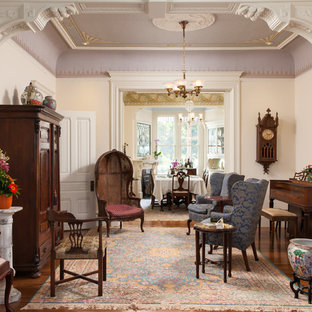 Ornate formal and enclosed medium tone wood floor living room photo in San Francisco with beige walls
