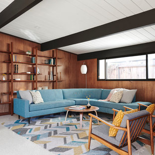 This is an example of a retro living room in San Francisco with brown walls and white floors.