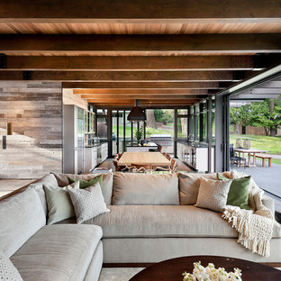 Example of a large mountain style open concept dark wood floor and black floor living room design in Seattle