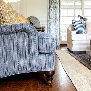 Ispirazione per un soggiorno minimal di medie dimensioni e aperto con sala formale, pareti bianche, pavimento in legno massello medio, camino classico, cornice del camino in cemento e nessuna TV
