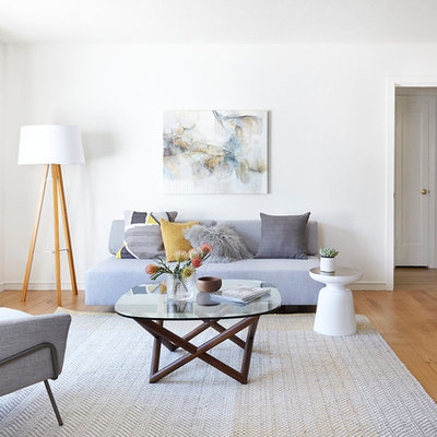 Mid-sized danish formal and enclosed light wood floor living room photo in San Francisco with white walls, no fireplace and no tv
