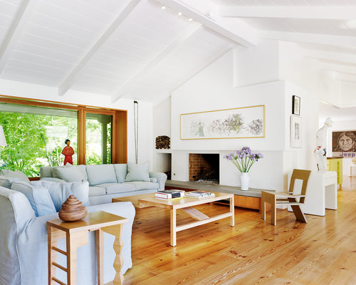 inspiration for a 1960s light wood floor living room remodel in san francisco with white walls