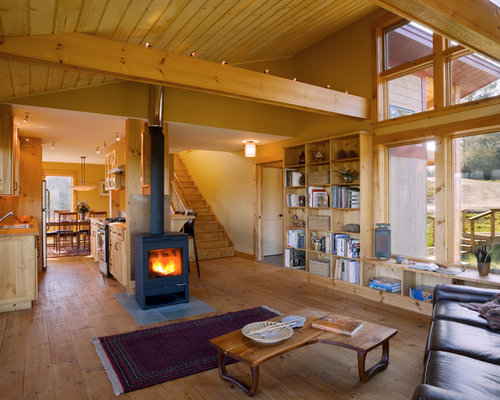 Inspiration for a rustic open concept living room remodel in Burlington  with beige walls and a - Jotul Wood Stoves Houzz