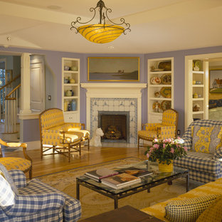Inspiration for a french country living room remodel in Boston with a corner fireplace, a tile fireplace and purple walls