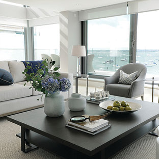 Inspiration for a medium sized nautical enclosed living room in London with white walls, carpet, no fireplace and no tv.