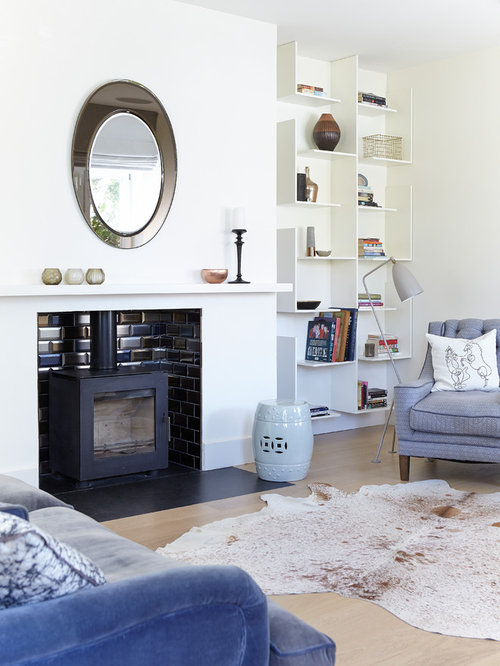 Transitional Light Wood Floor Living Room Idea In Dublin With White Walls  And A Wood Stove Part 94
