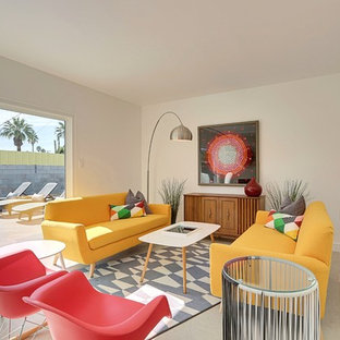 Inspiration for a mid-sized mid-century modern open concept concrete floor living room remodel in Phoenix with white walls