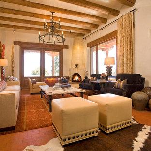 Idée de décoration pour un grand salon méditerranéen ouvert avec une salle de réception, un mur beige, un sol en brique, une cheminée d'angle et aucun téléviseur.