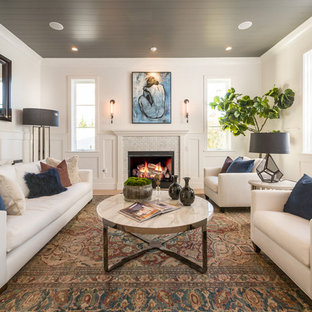 Example of a transitional formal living room design in Los Angeles with white walls, a standard fireplace and a tile fireplace