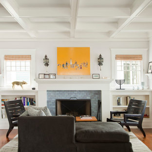 Coastal living room photo in Los Angeles with white walls, a standard fireplace and a tile fireplace