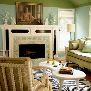 Mid-sized transitional formal medium tone wood floor living room photo in Los Angeles with green walls, a standard fireplace and a tile fireplace