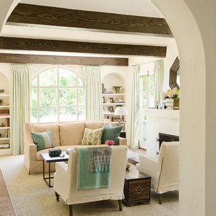 Inspiration for a large mediterranean enclosed terra-cotta tile living room remodel in Los Angeles with white walls and a standard fireplace