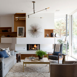 Inspiration for a modern living room remodel in Los Angeles with white walls and a standard fireplace