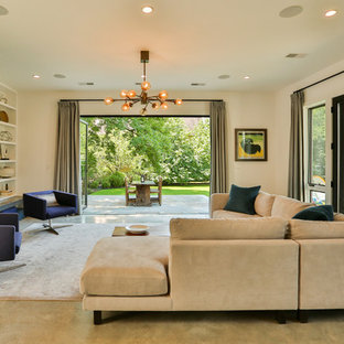 Mid-sized trendy open concept concrete floor living room photo in Boston with beige walls, a standard fireplace and a tile fireplace