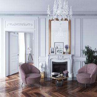 Inspiration for a large victorian formal enclosed living room in New York with dark hardwood floors, a standard fireplace, no tv and white walls.