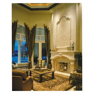マイアミの巨大な地中海スタイルのおしゃれな独立型リビング (フォーマル、ベージュの壁、トラバーチンの床、両方向型暖炉、石材の暖炉まわり、テレビなし) の写真